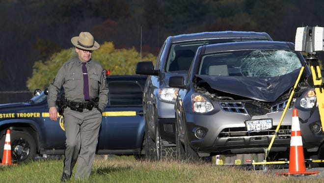 Investigators from the New York State Police look over the scene of an accident early Wednesday in Wilton.   A veteran state trooper was hit by a vehicle and killed when he got out of his cruiser to investigate a tractor-trailer parked in the median in front of the police station, authorities said. Trooper Timothy Pratt, 55, had stopped his patrol vehicle around 6:15 a.m. while on duty near the station where he worked in Wilton, 35 miles north of Albany, Maj. William Keeler said.