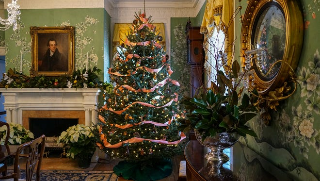 The Dining Room at Drumthwacket designed by The Garden Club of Stony Brook is decorated in traditional style with a woodland twist.