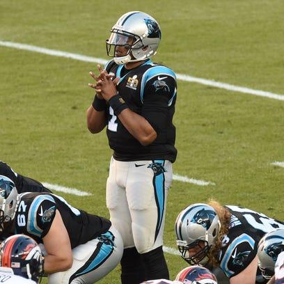 Carolina Panthers quarterback Cam Newton (1) says a