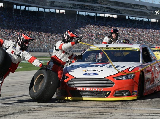 Brad Keselowski (2) pits during the NASCAR Sprint Cup Series auto race at Texas Motor Speedway in Fort Worth, Texas, Sunday, Nov. 8, 2015. (AP Photo/Ralph Lauer)