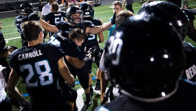Gulf Coast High School celebrates their win against South Fort Myers on Friday, October 28, 2016 at Gulf Coast High School in Golden Gate. Gulf Coast High School won the game, sending them to the playoffs.