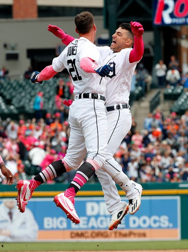 Detroit Tigers shortstop Jose Iglesias, right, celebrates