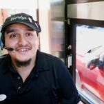 "Josh Lewis takes orders recently at the Wendy's in the Corkscrew Village shopping plaza in Estero. ""It is always good to make a differnce in someone's day,"" says Lewis."
