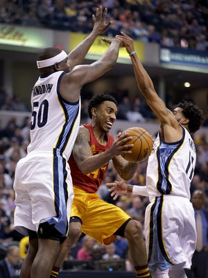 Indiana Pacers guard Jeff Teague (44) passes the ball between Memphis Grizzlies forward Zach Randolph (50) and Mike Conley (11) in the first half of their game Fridayday, February 24, 2017, evening at Bankers Life Fieldhouse.
