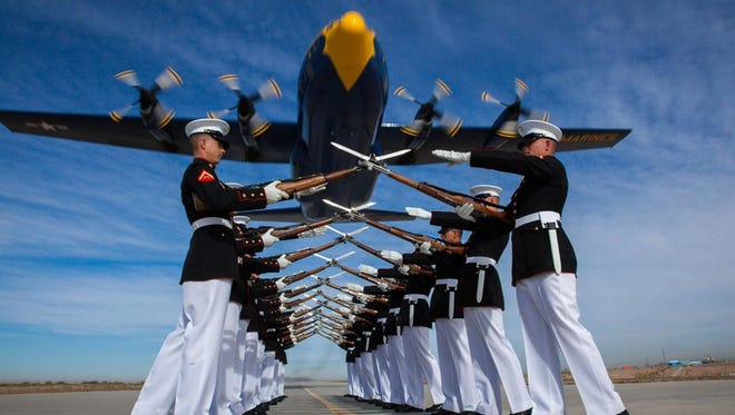The Blue Angels, Marine Corps' C-130 Hercules, flies over the Silent Drill Platoon at Marine Corps Air Station Yuma, Ariz., on March 4, 2014.