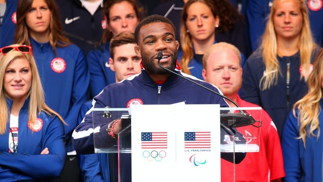 Olympic wrestler Jordan Burroughs introduces First Lady Michelle Obama during Team USA's Road to Rio Tour presented by Liberty Mutual on April 27 in New York.