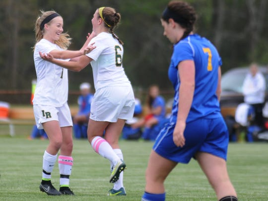 Indian River's Brooke Beam, left, and Sarah Buchler embrace after connecting for a goal.