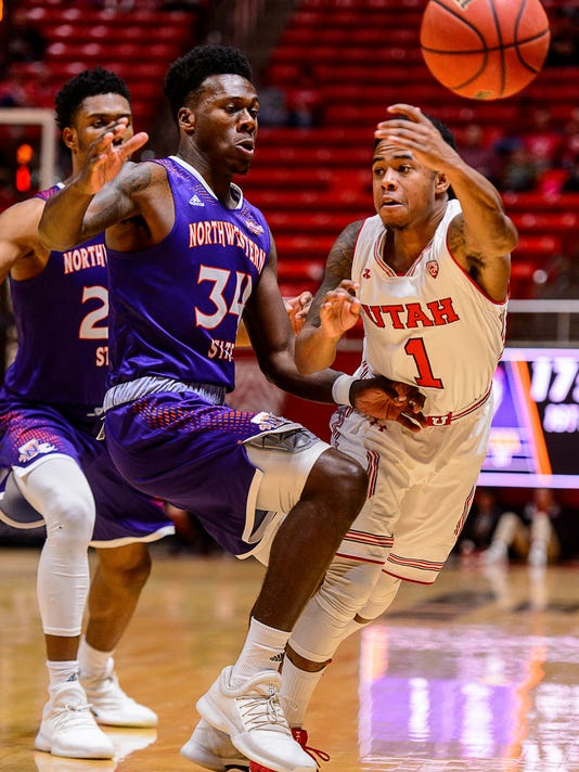 Utah guard Justin Bibbins (1) passes the ball as Northwestern State forward Brandon Hutton (34) defends during an NCAA college basketball game in Salt Lake City, Wednesday, Dec, 20, 2017. (Trent Nelson/The Salt Lake Tribune via AP)