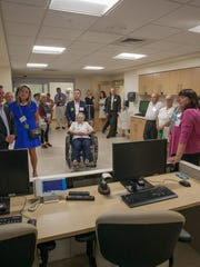 A group tours the new Glen and Rosemarie Wright Mother-Baby Unit at UVM Medical Center.