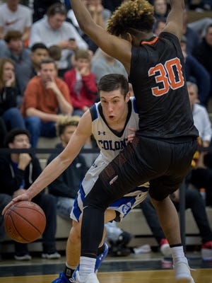 Covington Catholic's CJ Fredrick (1) collides with Fern Creek's Devean Franklin (30) during their at the King of the Bluegrass Holiday Classic in Fairdale, Ky, Thursday, Dec. 22, 2017