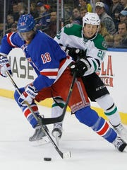 New York Rangers defenseman Marc Staal (18) defends Dallas Stars center Cody Eakin (20) in the first period of an NHL hockey game at Madison Square Garden in New York, Sunday, Feb. 8, 2015. (AP Photo/Kathy Willens)
