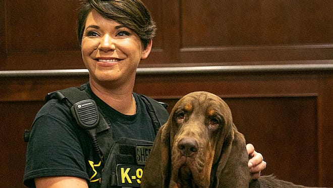 K9 Handler Cpl. Moses poses with Rhys, a bloodhound who has become the fifth K9 in the Craven County Sheriff's Department.