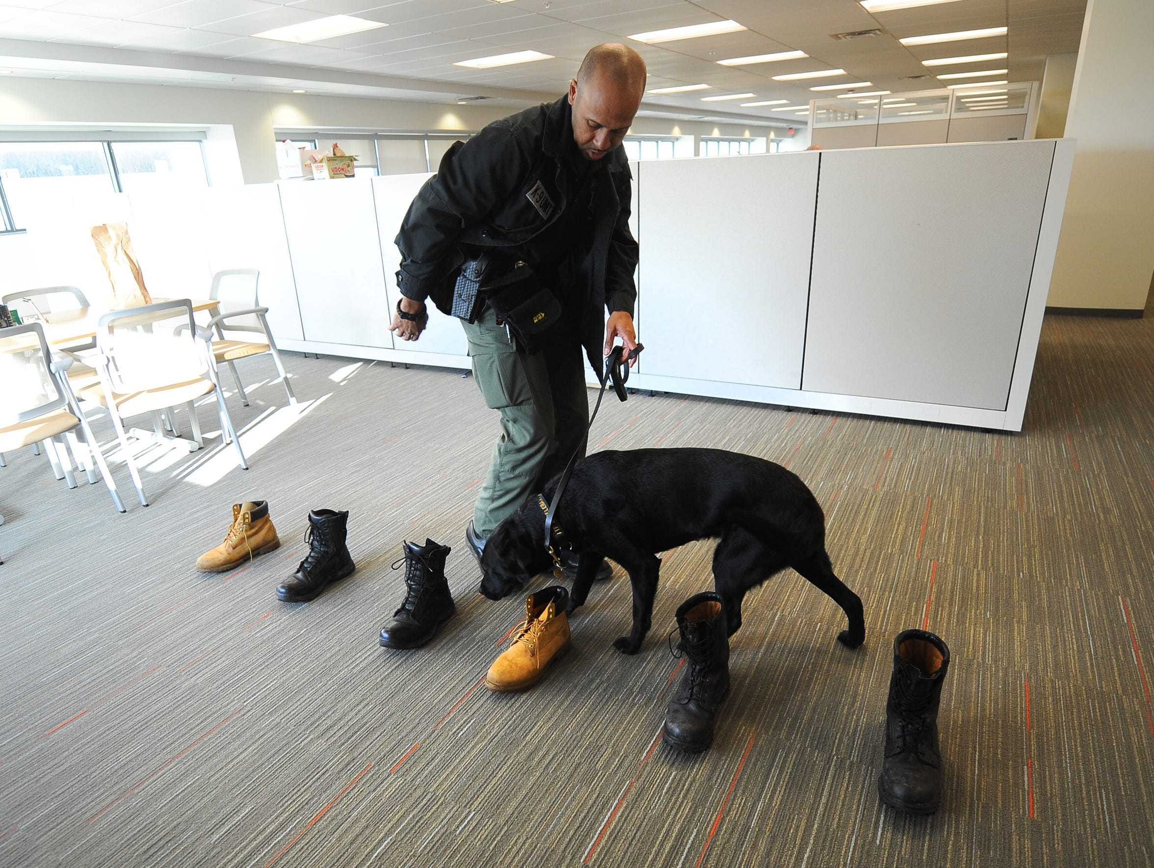Lt. Omar Davidson works with ATF-trained arson dog