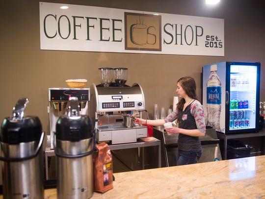 Manager Stephanie Krug makes a latte for a customer