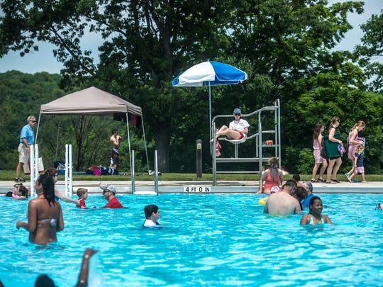 Swimmers relax at the Codorus State Park swimming pool on May 29, 2016.