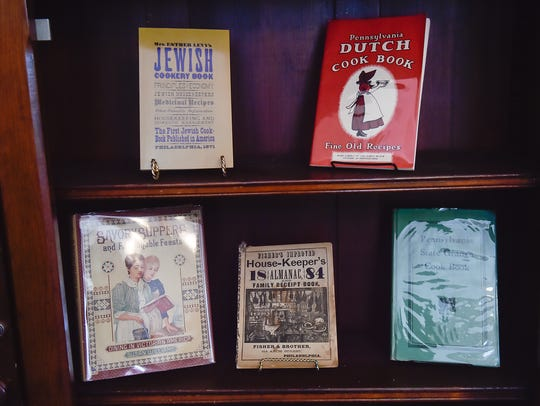 Rare and vintage cookbooks are displayed inside the