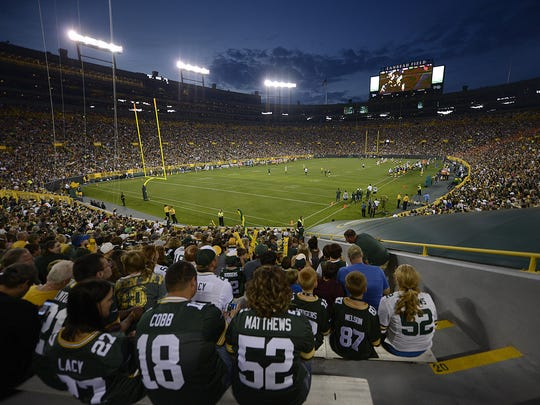 Fans watch the Green Bay Packers during Packers Family Night at Lambeau Field on Aug. 8, 2015.
