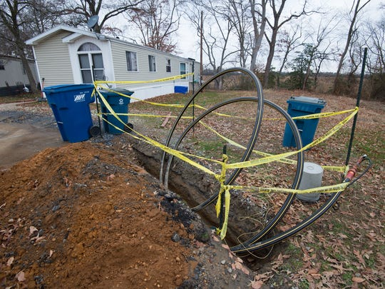 Natural gas lines being installed at St. Jones Landing in Magnolia.