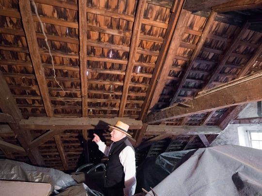 Mike Beshore, of the Manchester Township Historical Society describes the construction of the roof at the Peter Wolf House during a North Eastern York County History in Preservation tour.