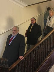 "Attorney Franklin ""Frankie"" Coyner (middle) leaves court in 2016 after a felony charge of obtaining money by false pretenses was not pursued by a special prosecutor."