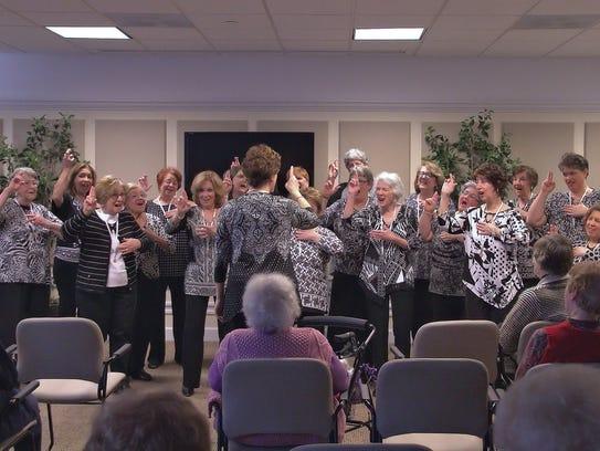 Members of the Evergreen chorus perform at Arbor Ridge