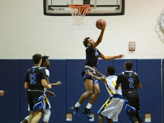 Decatur's Kevon Voyles with the reverse layup against Pocomke High School on Monday, Dec. 12, 2017 in Pocomoke City, Md.