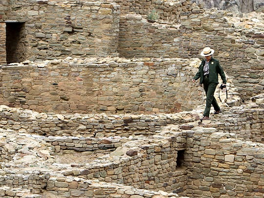 A ranger walks at Aztec Ruins National Monument on