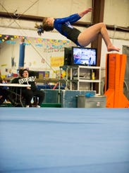 Junior Ava Farquhar placed ninth all-around for Farmington