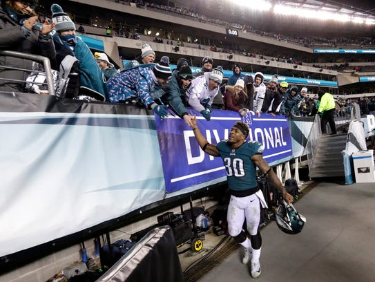 Eagles running back Corey Clement celebrates with fans