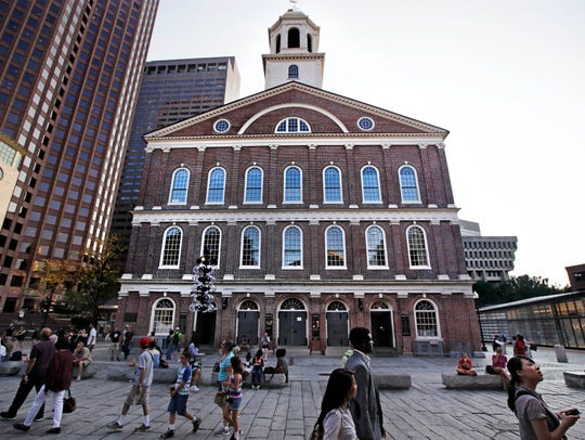 "Pedestrians pass Faneuil Hall, also known as ""the Cradle"