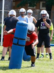 Mosinee's football team works on drill during Tuesday practice at Mosinee High School football field.