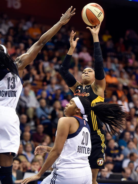 Tulsa's Odyssey Sims (0) shoots over the defense of Connecticut's Chiney Ogwumike (13) and Alex Bentley (20)in the first half of a WNBA basketball game, Thursday, July 3, 2014 at Mohegan Sun Arena in Uncasville, Conn. The visiting Shock raced away with a 96-83 win. (AP Photo/The Day, Sean D. Elliot)  MANDATORY CREDIT: THE DAY/SEAN D. ELLIOT