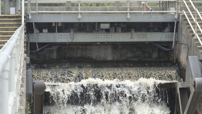 """""""You can't do anything about the weather, you just have to try and manage it,"""" said Orville Macomver, of Palm City, about the Lake Okeechobee discharges coming through the St. Lucie Lock and Dam near Stuart on Thursday, June 16, 2016. To keep the lake at a certain level, the U.S. Army Corps of Engineers orders water discharges to canals to the east and west of the lake. """"Frequent rain in the area has caused the lake to resume its rise,"""" said Corps Jacksonville District Operations Division Chief Jim Jeffords in a news release."""