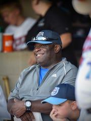 Rox third-base coach Al Newman smiles before the start