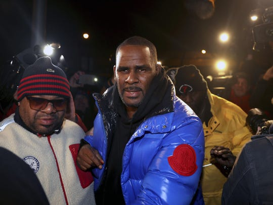 R. Kelly turns himself in at 1st District police headquarters in Chicago on Friday night, Feb. 22, 2019. R&B star R. Kelly arrived Friday night at a Chicago police precinct, hours after authorities announced multiple charges of aggravated sexual abuse involving four victims, including at least three between the ages of 13 and 17.