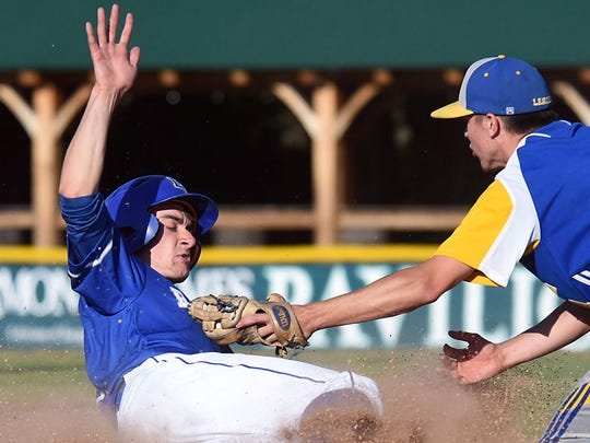 Lake Region runner Noah Royer is tagged out at third base by Lamoille's Garrett Martin in the Division II high school baseball championship at Centennial Field on Saturday, June 9, 2018.