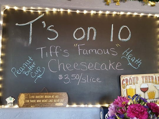 A sign at the T's on 10 bar promoting Tiffany Miller's famous cheesecake.