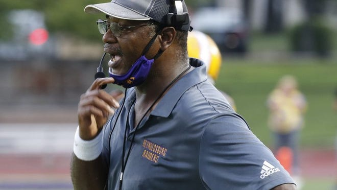 Reynoldsburg coach Buddy White directs his team against Gahanna on Aug. 28.