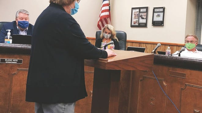 Ripley High School teacher, Barbara Heckert, told the board that she supported five-day attendance when school started, but no longer felt it was safe.