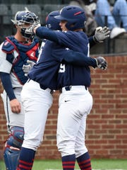 Vanderbilt outfielder Stephen Scott (19) is congratulated