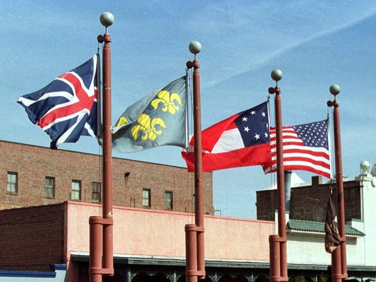 -The Confederate Stars and Bars flag, center,has been ordered by Mayor Ashton Hayward to be removed.