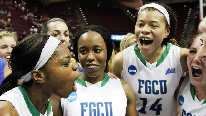 """We'e not going home,"""" exclaims FGCU's Kaneisha Atwater, left, after FGCU beat Oklahoma State University on Saturday in the NCAA Division I Women's Basketabll Championship first round game at the Donald L. Tucker Civic Center in Tallahhassee"""