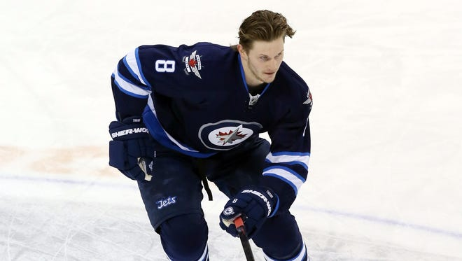 Winnipeg Jets defenseman Jacob Trouba warms up prior to a game against the Buffalo Sabres on Jan. 10, 2016.