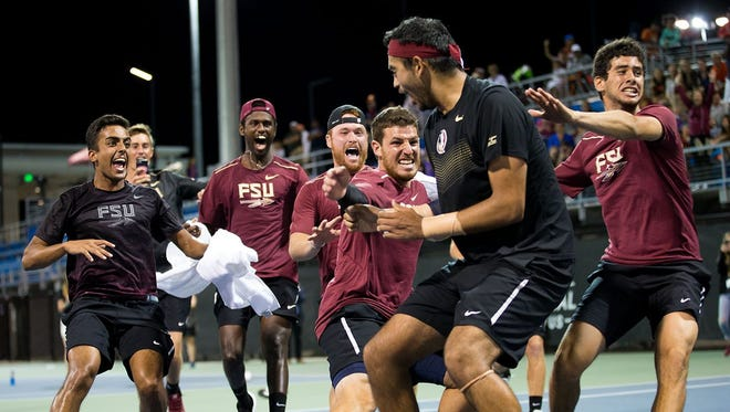 Florida State's men's tennis team celebrates after Jose Gracia clinches the match-winning point against Florida during the 2017 Match Day event in Lake Nona.