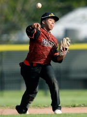 Franklin's Julian Cotto thorws to first base after