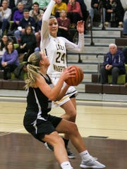 Watchung Hills' Julia Cunningham tries to block Bridgewater-Raritan's Meghan Ball from scoring during the first half of a girls basketball game at Watchung Hills on December 15, 2017.  Alexandra Pais/ for the Courier News