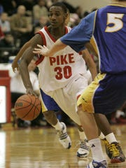 Pike's Marquis Teague (30) drives the ball between the Carmel  in 2009.