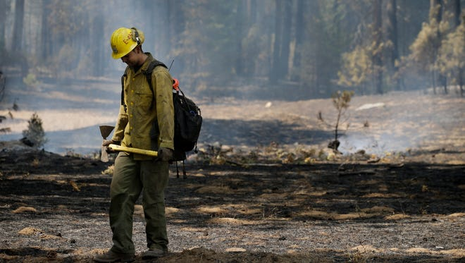 Firefighter Troy Drouin takes a short break before mopping up hot spots near Yosemite National Park, Calif., on Aug. 28.