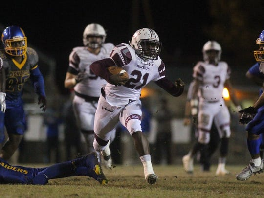 Madison County running back Vinsonta Allen rumbles for a good chunk of yardage against Rickards.