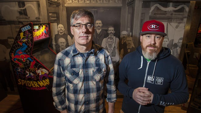 The Archives arcade bar co-owner Matt Walters, left, and General Manager Matthew Marrier in part of the former Burlington Free Press building on College Street on Tuesday, March 29, 2016.
